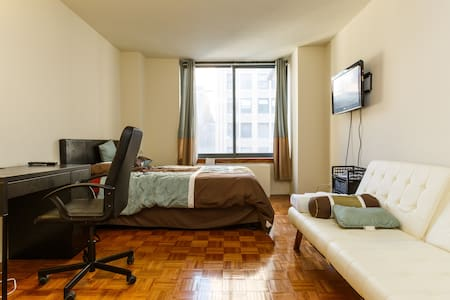 Located on 36th street & 6th avenue. In the heart of Manhattan, with 7 subway lines a block away. Bryant Park, Macy's, Times Square, all less than a 5 minute walk away.  The bedroom has a queen bed that fits two and also a sofa bed