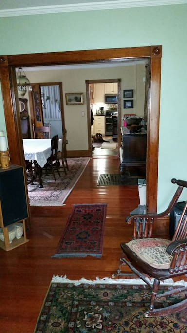 Fir floors with Persian rugs in dining and living rooms.