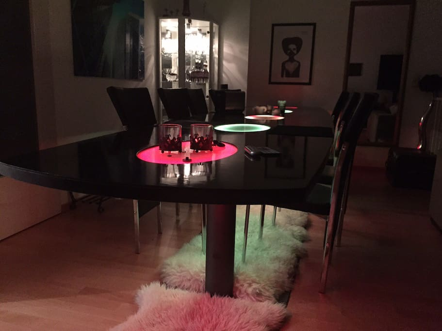 Large dining table with colour LEDs (changeable).