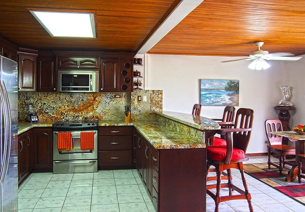 Fully equipped Kitchen with Breakfast Bar for extra seating.