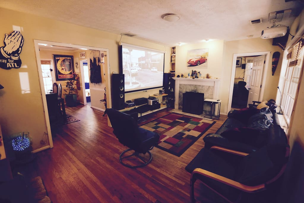 Living room with 130 inch (retractable) screen w/cable and Netflix