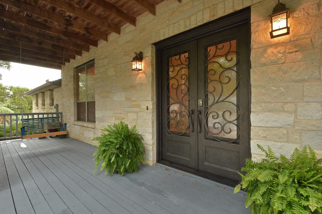 Intricate front doors welcome you to your vacation.