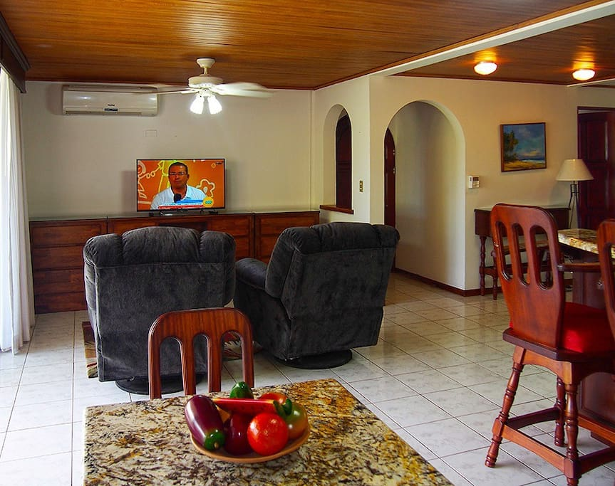 Living room with Smart TV & most English Channels available in the area.