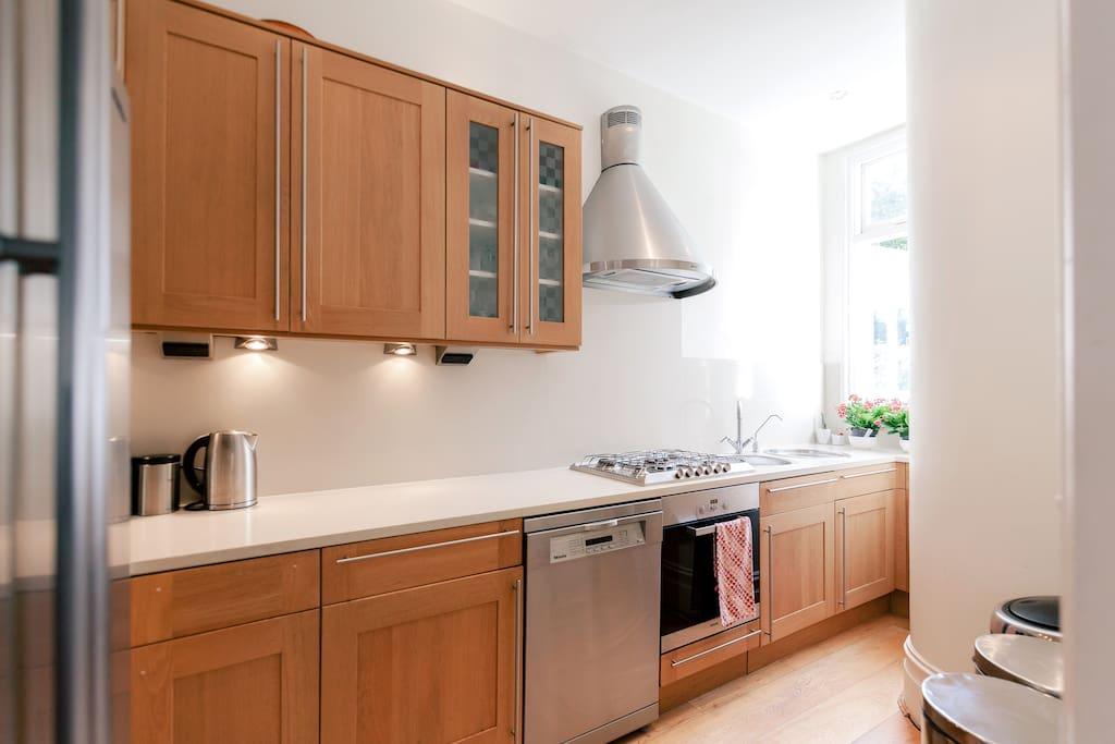 Kitchen with dishwasher, oven, gas, fridge freezer, toastie maker and Nespresso machine