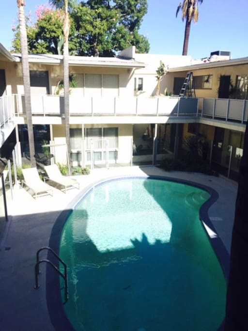 Kidney shaped pool in charming mid century modern building.