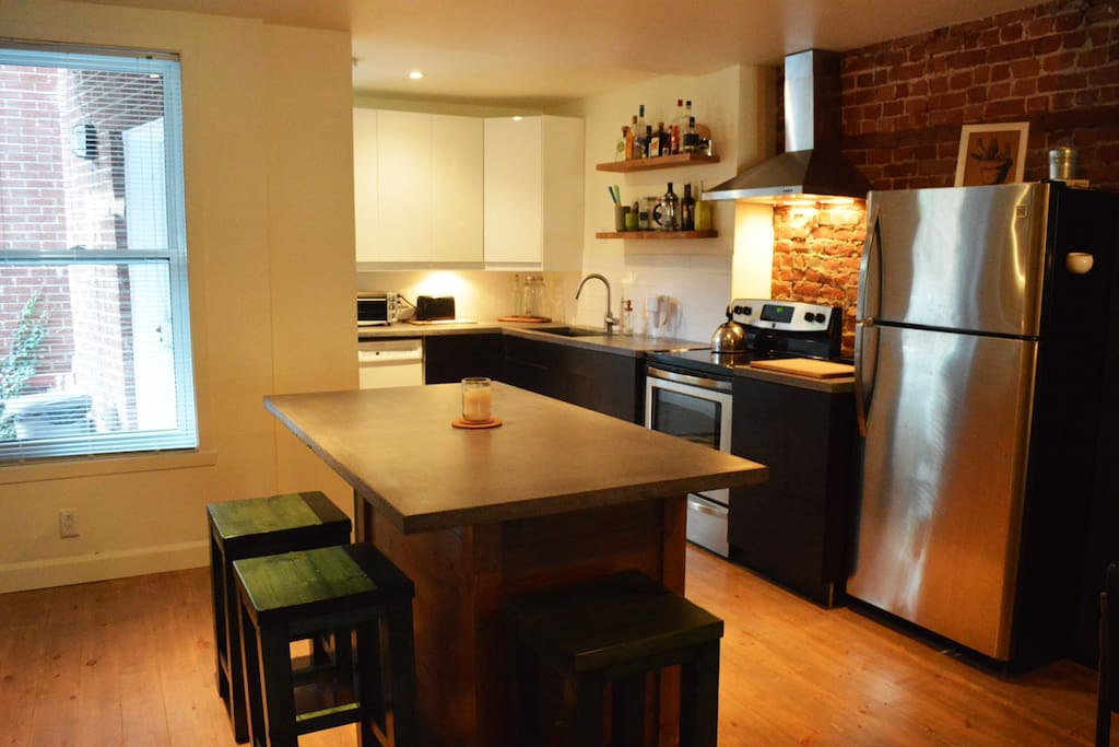 Kitchen with island counter, spacious fridge (no microwave).