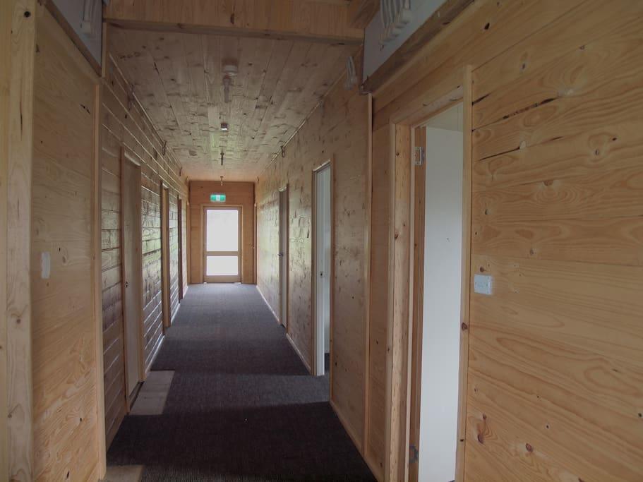 Bunkhouse hallway, wood finish