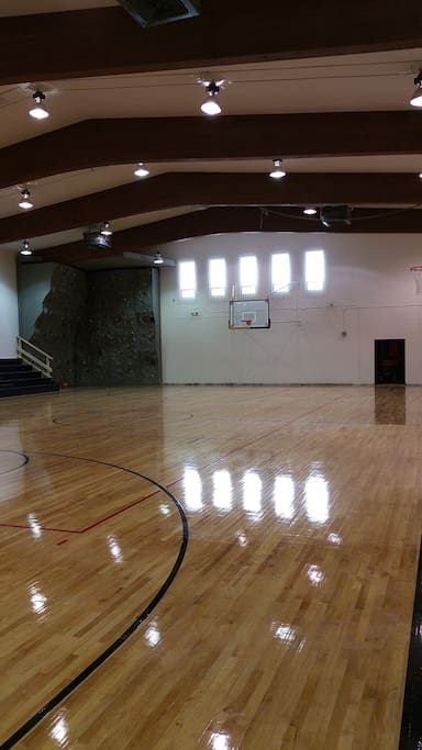 Full indoor basketball and volleyball court with rock climbing wall