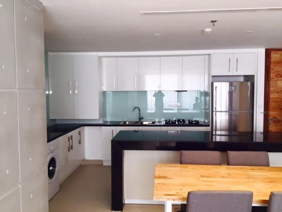 Fully functional kitchen with plates, glasses, kettle and cutlery