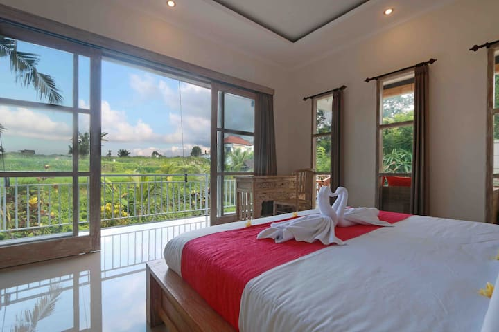 The bedroom faces directly to the very beautiful view of the rice fields