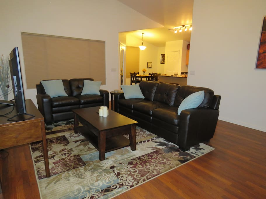 """Living room, leather couch & love seat, 50"""" smart tv"""