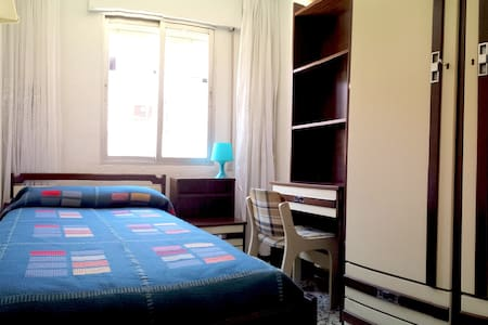 Private room in a quiet flat with kitchen and all amenities, bathroom and living room. The flat is very bright and confortable. 5 minutes walk to underground station and 15 min by train or by underground to Madrid city centre (Puerta del Sol).
