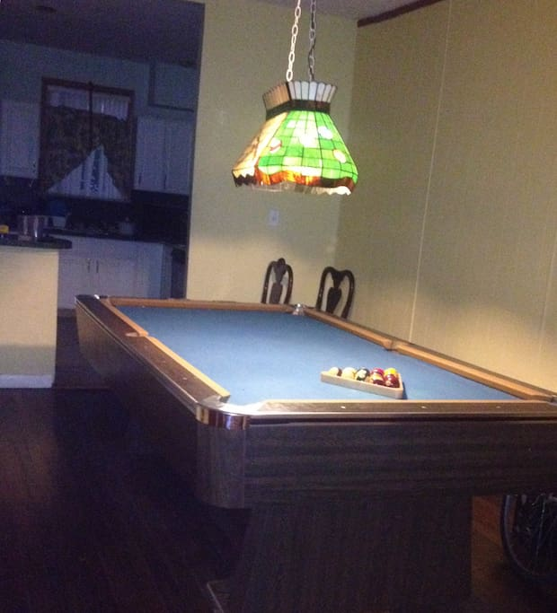 Pool table next to Full Kitchen.