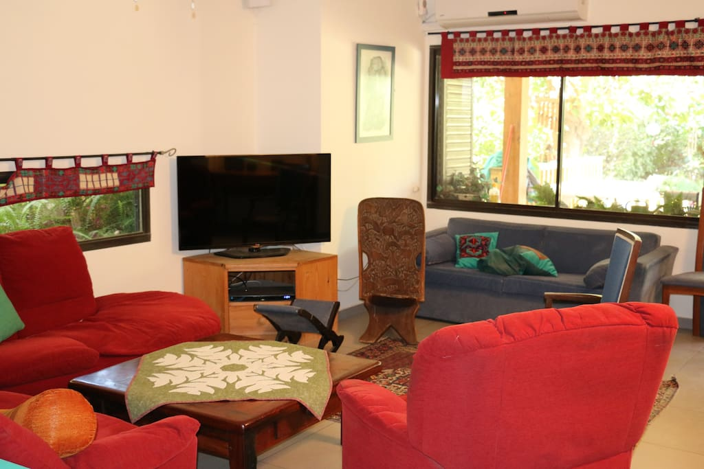Comfortable lounge area with large flat screen television.