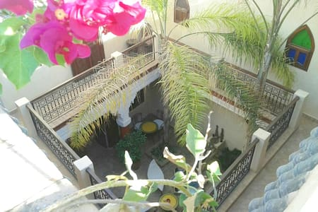Operated by Belgian owner.     3  ROOMS  3 BATHROOMS    AVAILABLE  A traditonal house in authentic popular neighborhood.  All points of interest accesible on foot.  24h/24h airport transfers ! 24h/24h reception ! Meals,transports, excursions etc .