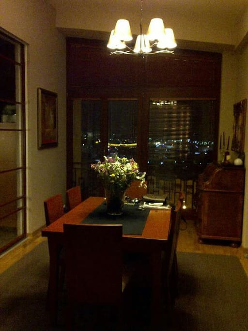 Dining in the evening, stonning view comes from the large windows, city lights