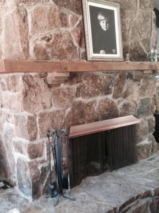 Large woodburning fireplace.