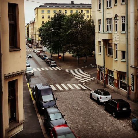 Down Eerikinkatu. The pictures are taken out from inside the apartments bay window area.