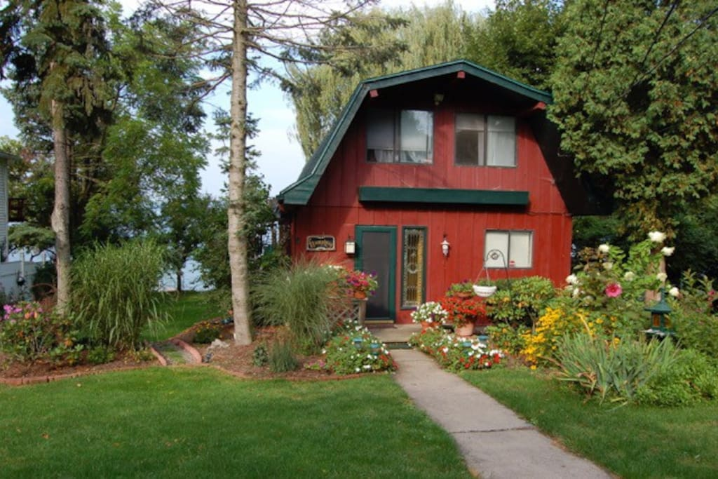 Charming lake cottage with mature perennial gardens.