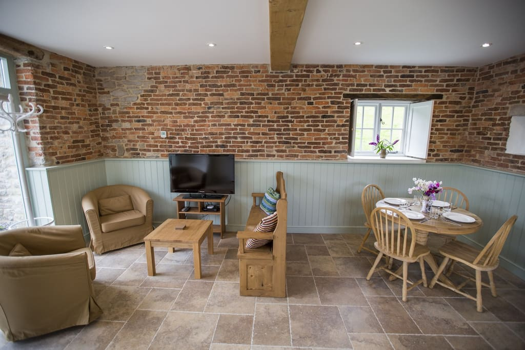 Inside the living room is lined with original hand made brick.