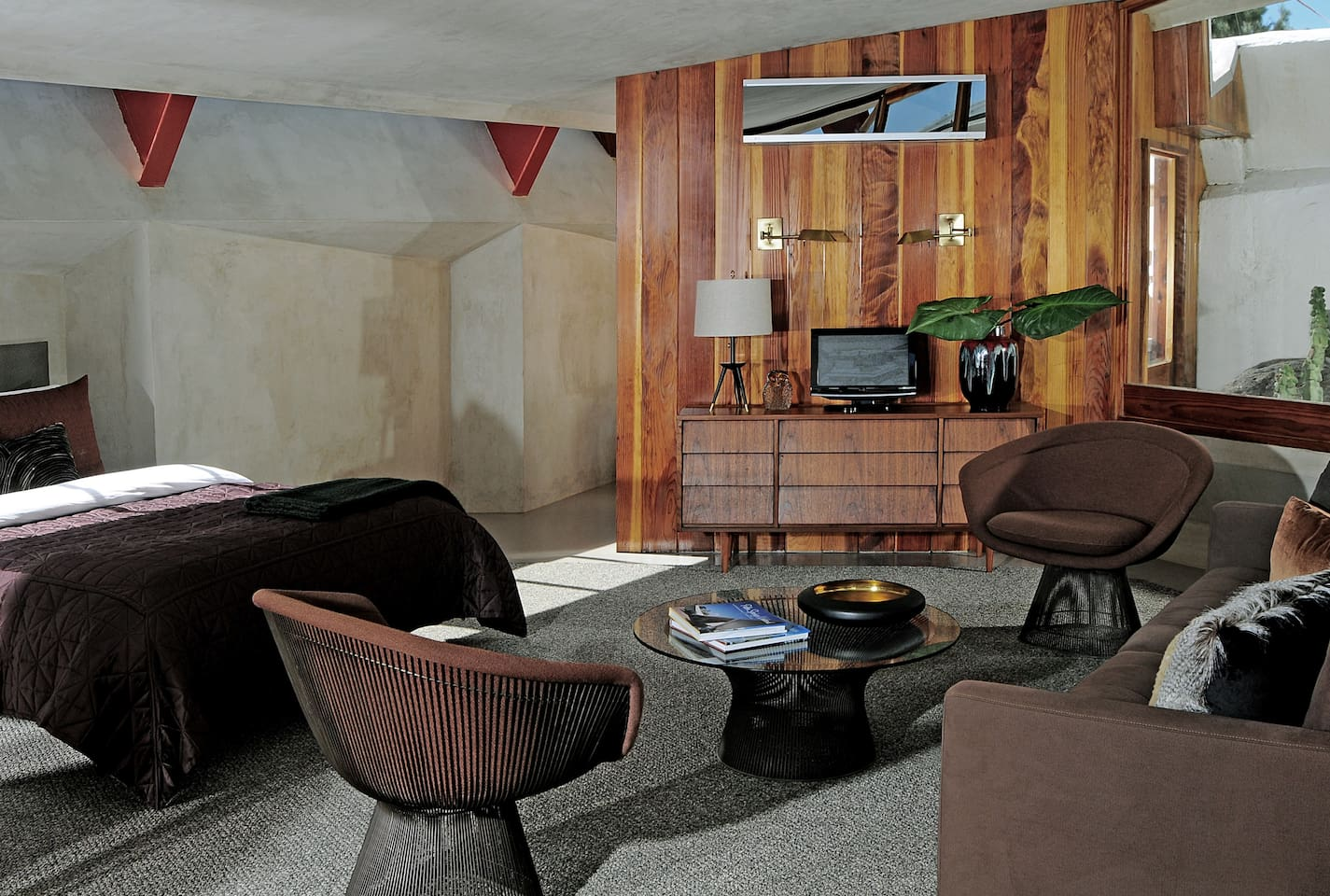 A redwood wall separates the living areas from the kitchenette.