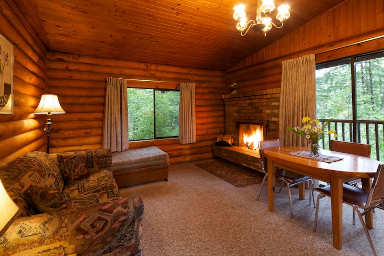 Cozy fireplace and view of beautiful Cusheon Lake