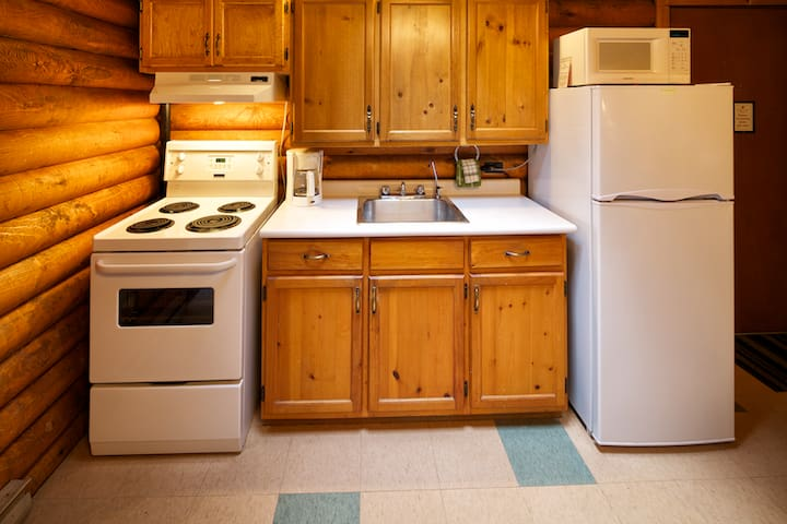Fully equipped kitchen with all the pots, pans, plates and cutlery you could need!