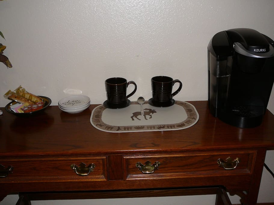 Keurig Coffee Maker in your room with cream, sugar & Biscotti. Tea and Coffee in drawer below.