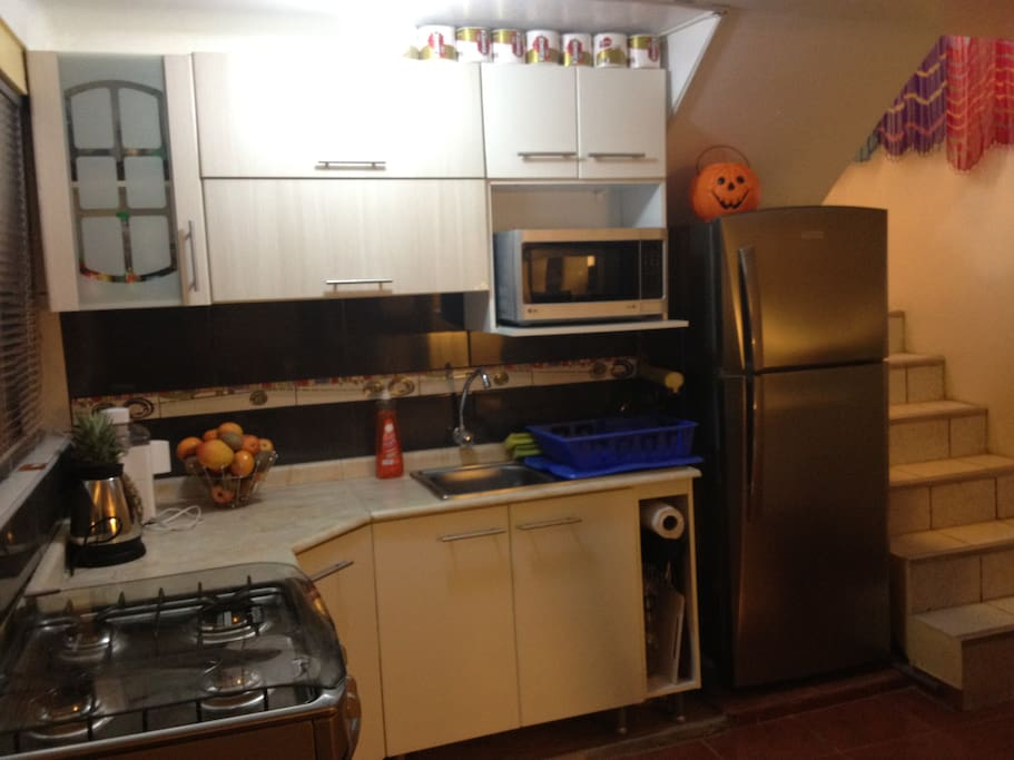 Brand new kitchen with fridge, microwave, stove, all cooking utensils