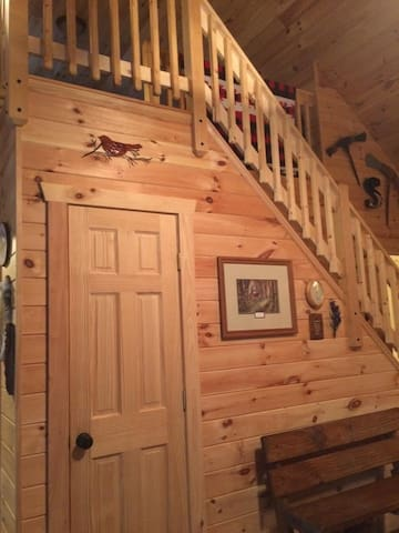 The smell of knotty pine follows you up to the loft bedroom.