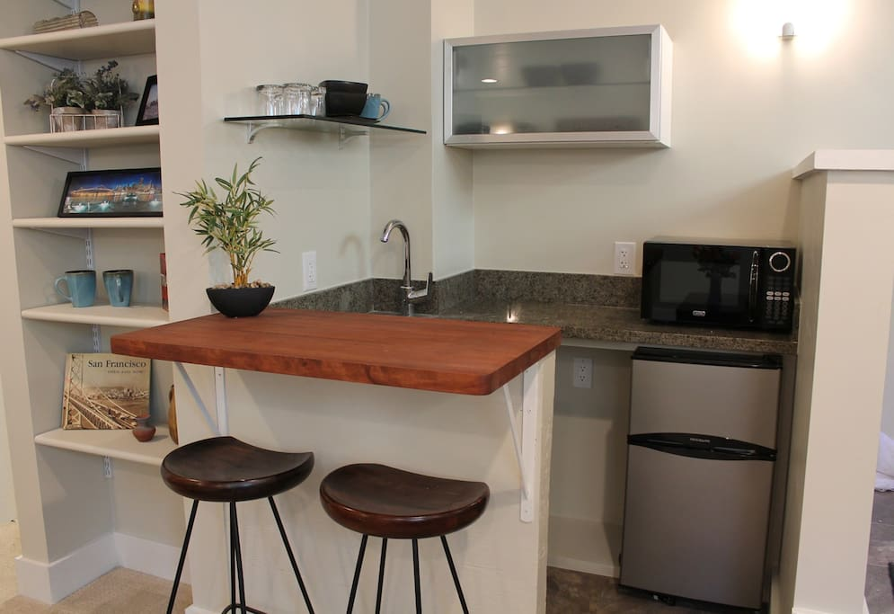 Kitchenette with seating for 2 at bar, refrigerator/freezer, microwave and the basics (no stove)