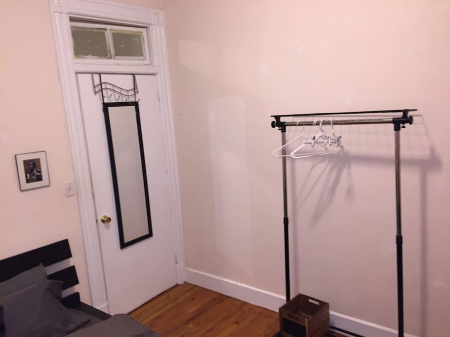 This room is the middle room of our three bedroom brownstone. The window in the room is located above the door that leads to the living room.