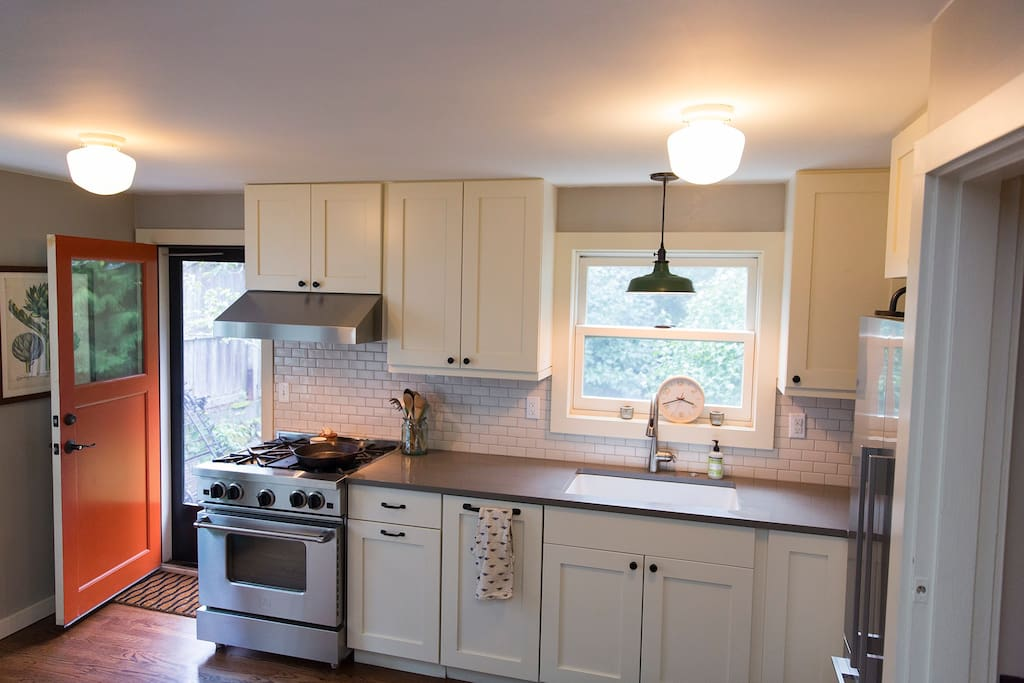 Charming kitchen with gas range.