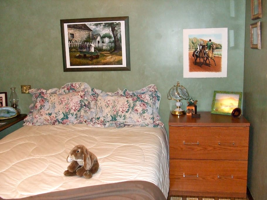 That is Snoopy the rabbit on  the bed....