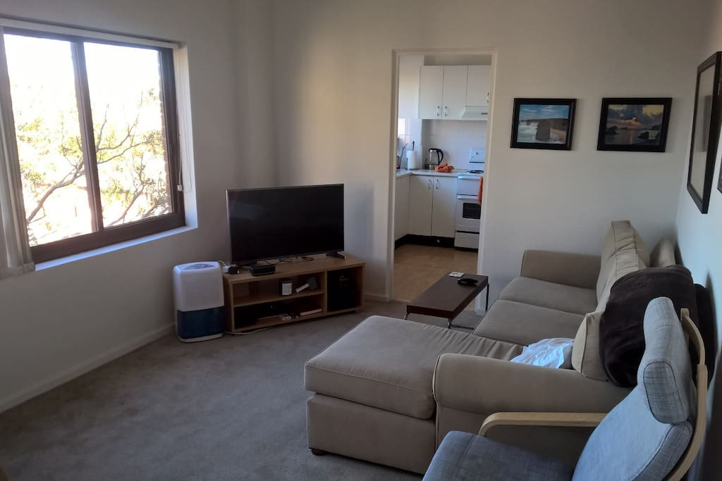 """Living room with great views of the beach and Bondi, 42"""" TV and unlimited WiFi"""