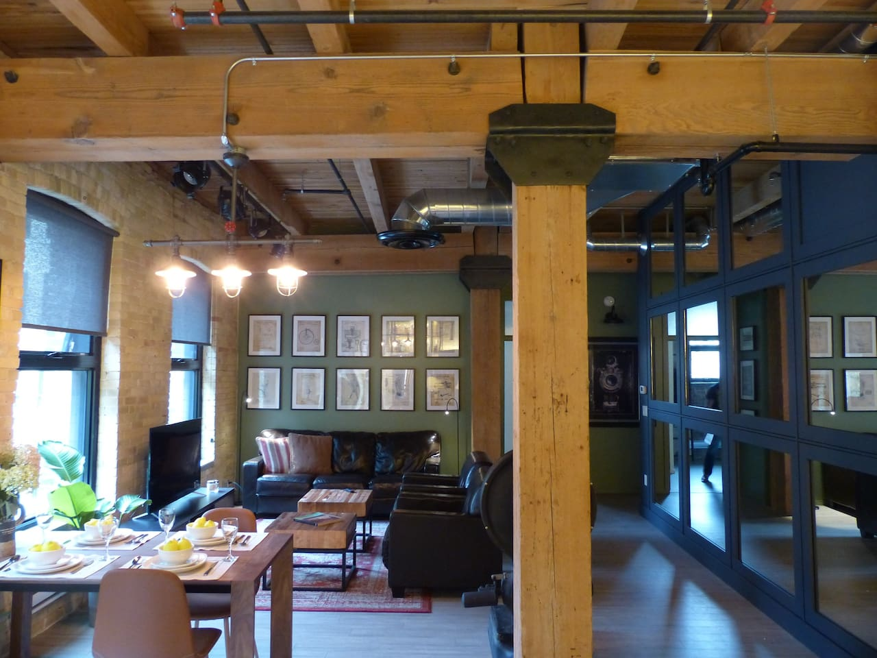 Open concept with 100 year old exposed Brick and Heavy Timbers. These are some of the architectural features that make this loft so inviting