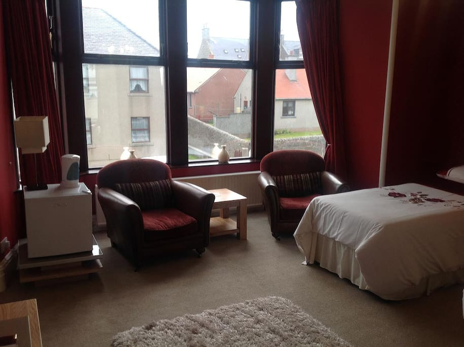The sitting area and single bed
