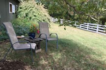 Outdoor seating in the shade of our dogwood tree offers views of the pasture.