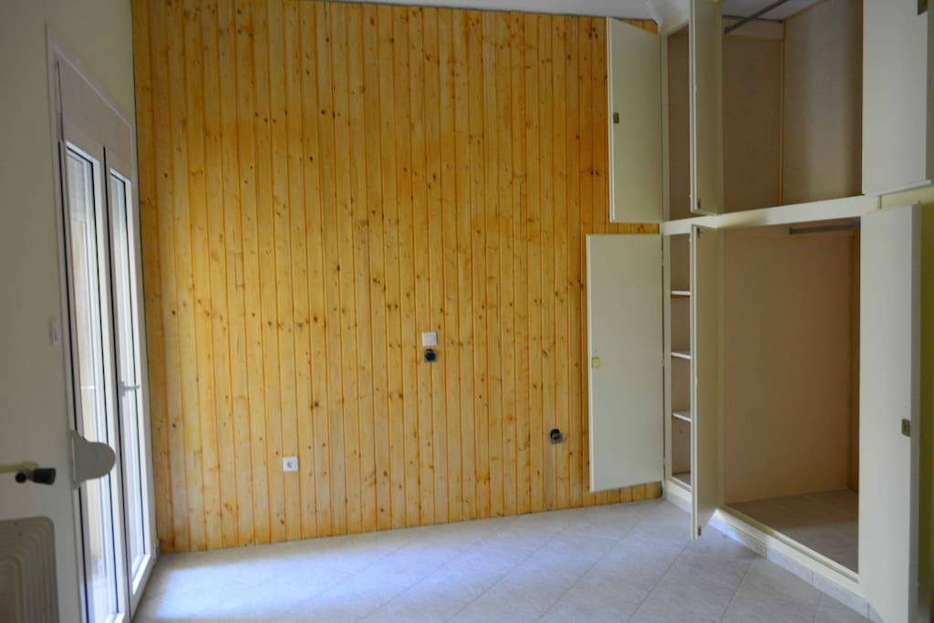 Woodcarved wall with huge closets