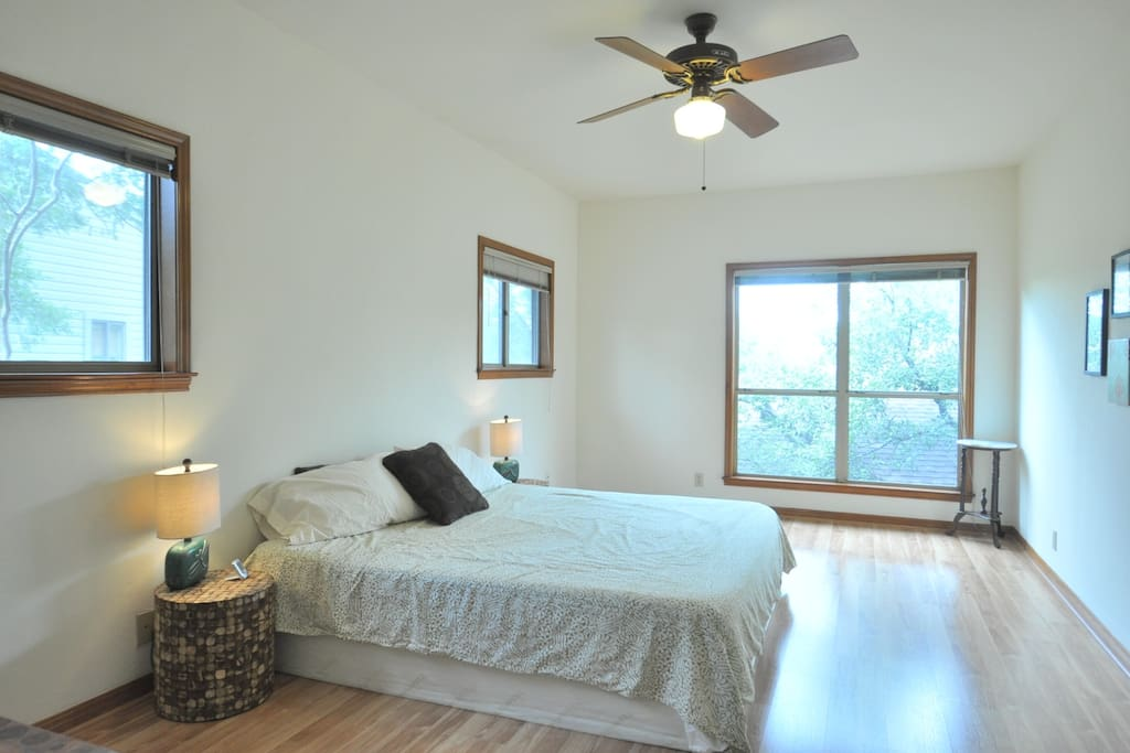large master bedroom with king size tempurpedic mattress, and view of the treetops