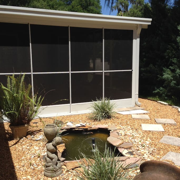 Private lanai & courtyard with pond & fountain.
