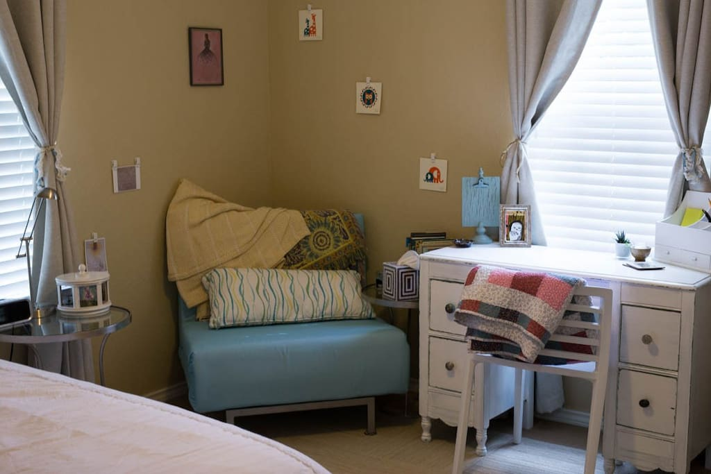 The teal chair pulls out into a twin bed for an extra guest.