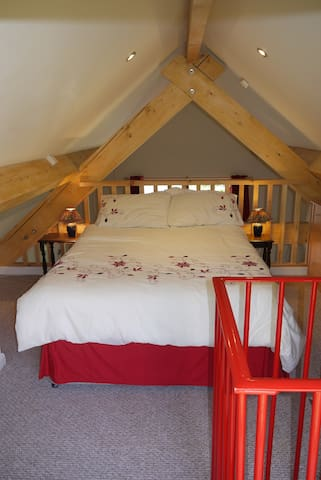 Mezzanine bedroom. Sheets and towels provided