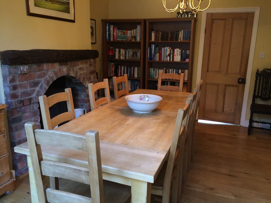 Solid oak dining table (seats 8) with traditional fireplace and lots of books