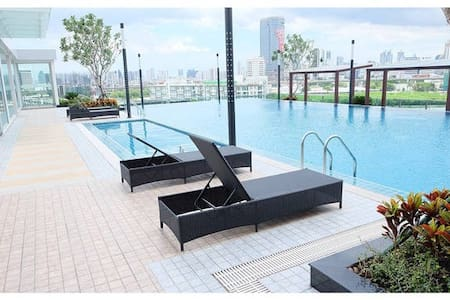 The Condo New room (with kitchen, aircon ,gym, swimming pool & FREE WIFI). Located in center only 7 mins walking to MRT Rama 9 and 1 station to airport link,very convenient for your travel in BKK.  Close to Central rama9 to eat & shopping.
