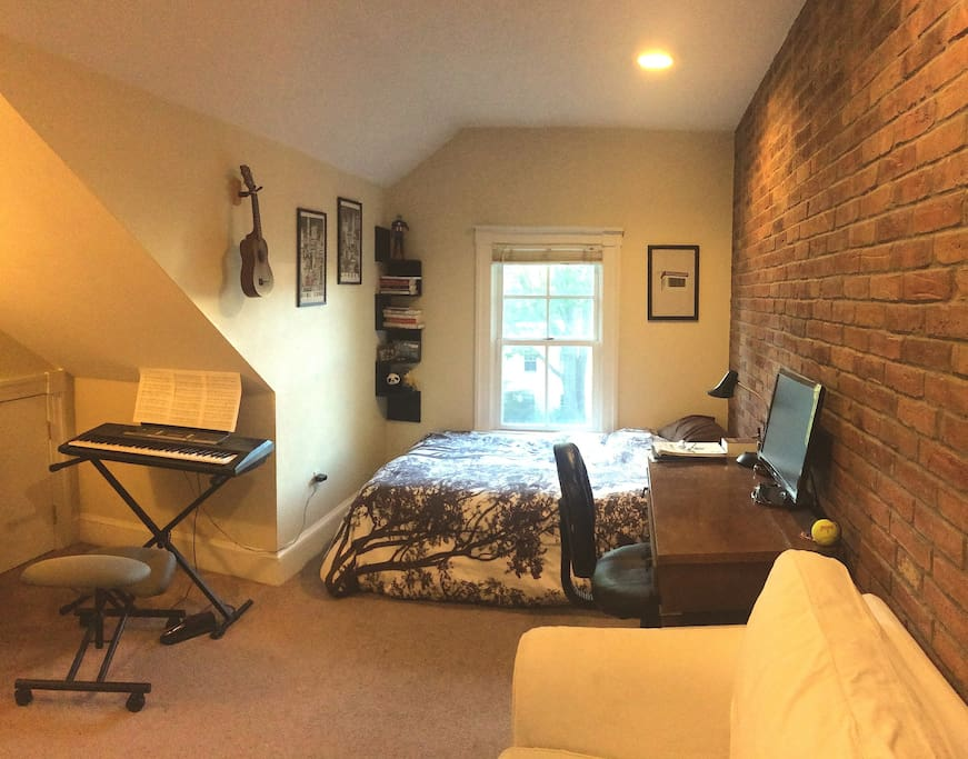 Double bed, desk, 24 inch computer monitor, couch, keyboard