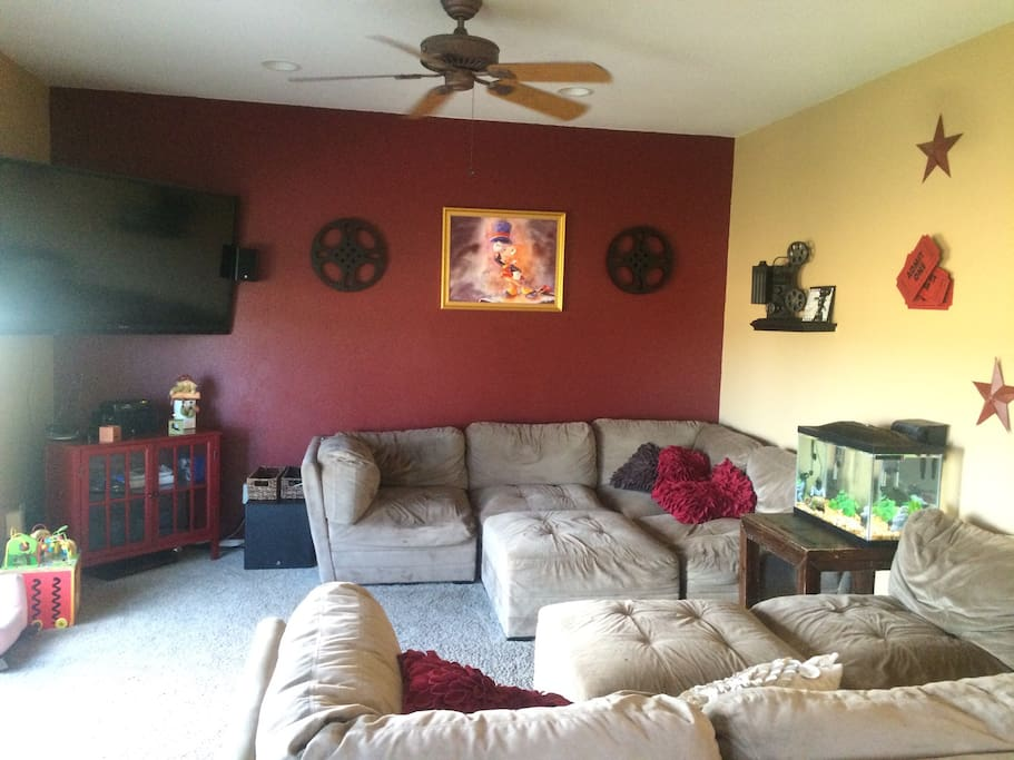Family room with 60 inch television, blue ray, DVD player and video game systems.