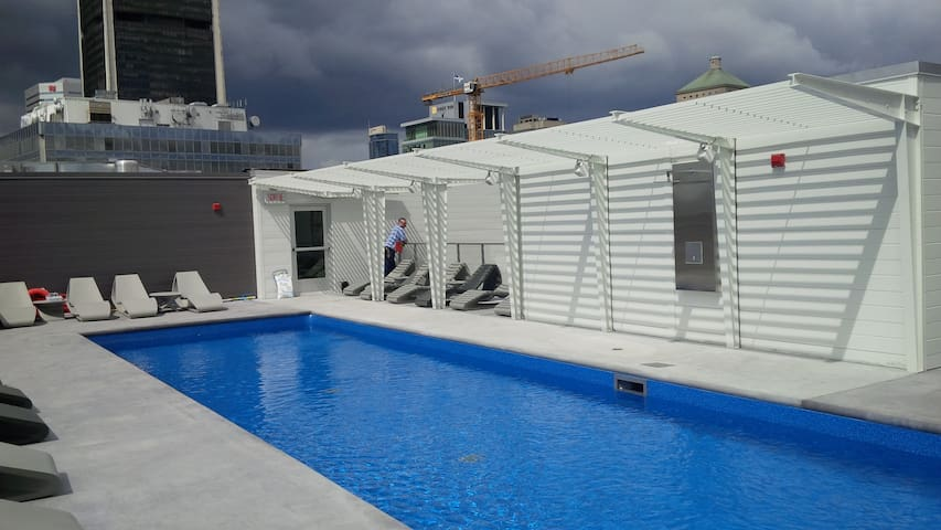 Solar panels heated roof swimming pool