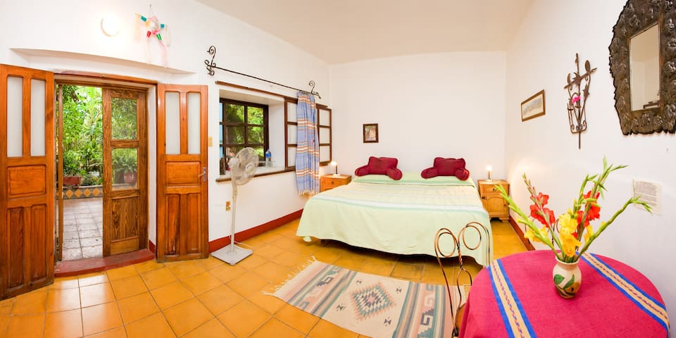 One of Casa Colonial's beautiful double rooms complete with goose-down pillows and traditional Mexican blankets.
