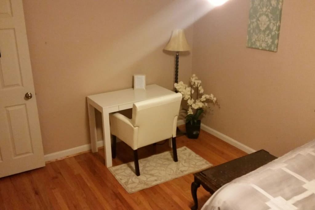 Your guest room with a desk, chair, and reading lamp.